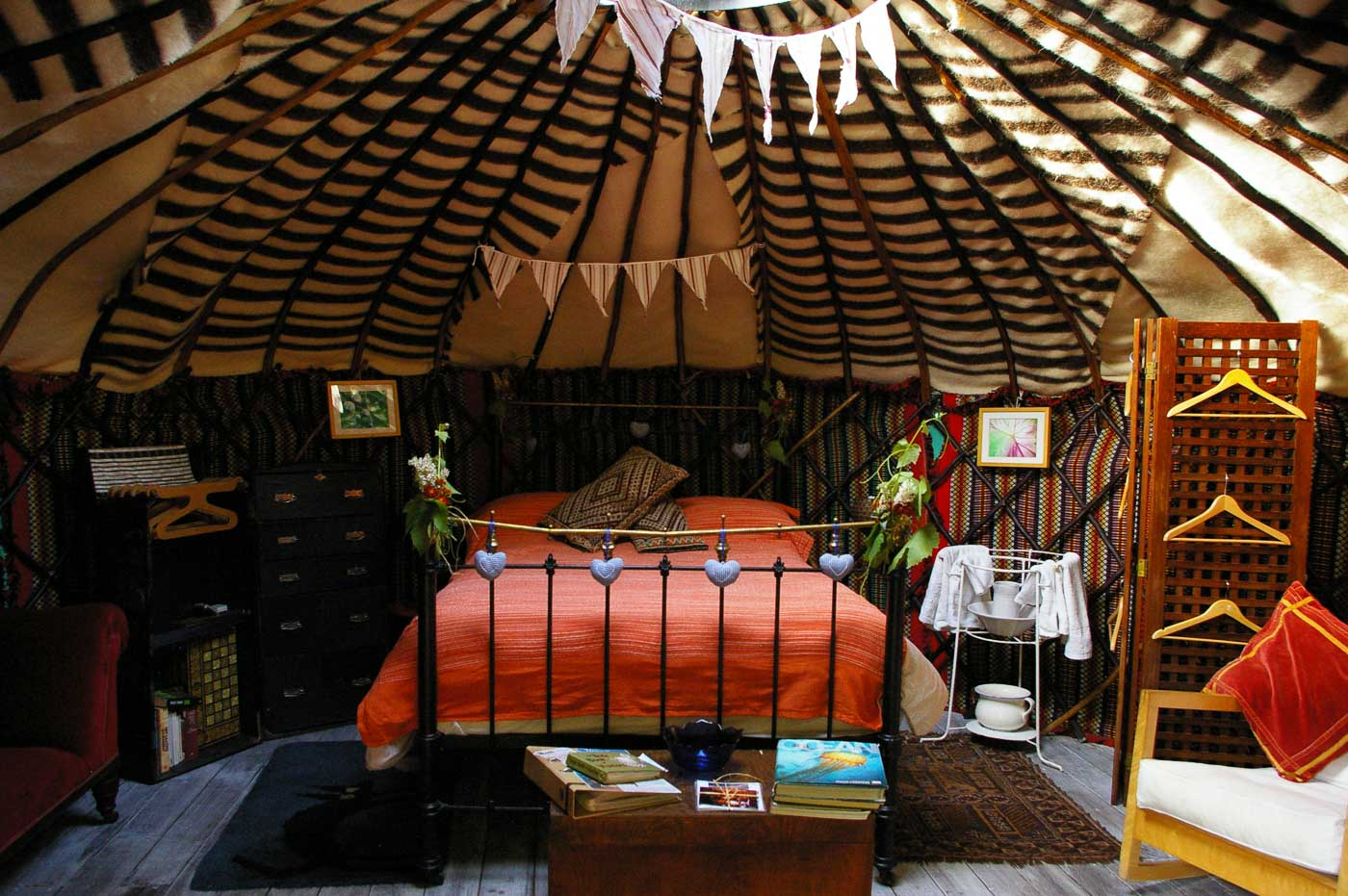 Two yurts are self-contained and furnished in a chic, vintage style; each  yurt has its own bathroom, set in a small holding of terraced land.